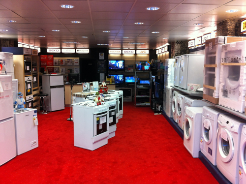 Photo of inside the store showing washing machines, cookers, and televisions.