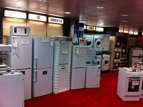 Photo of inside the store showing a display of fridge freezers.